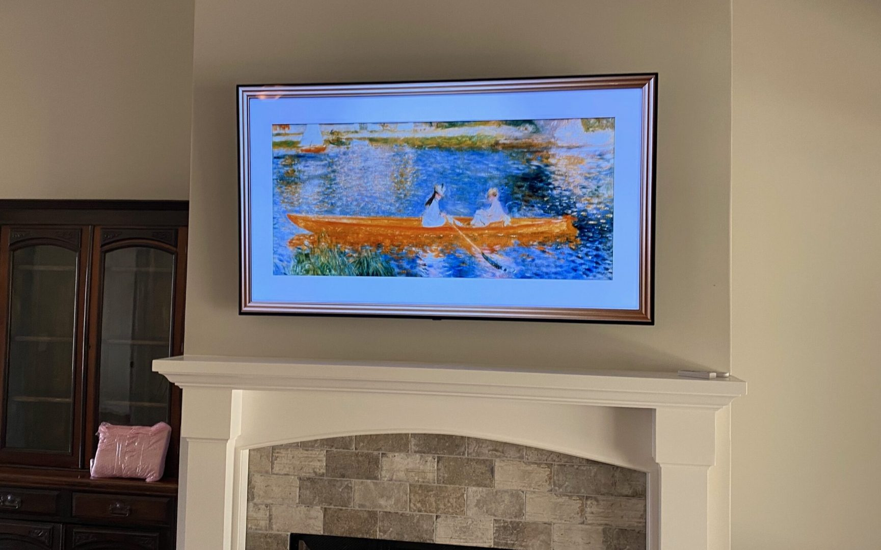 TV mount and installation over fireplace