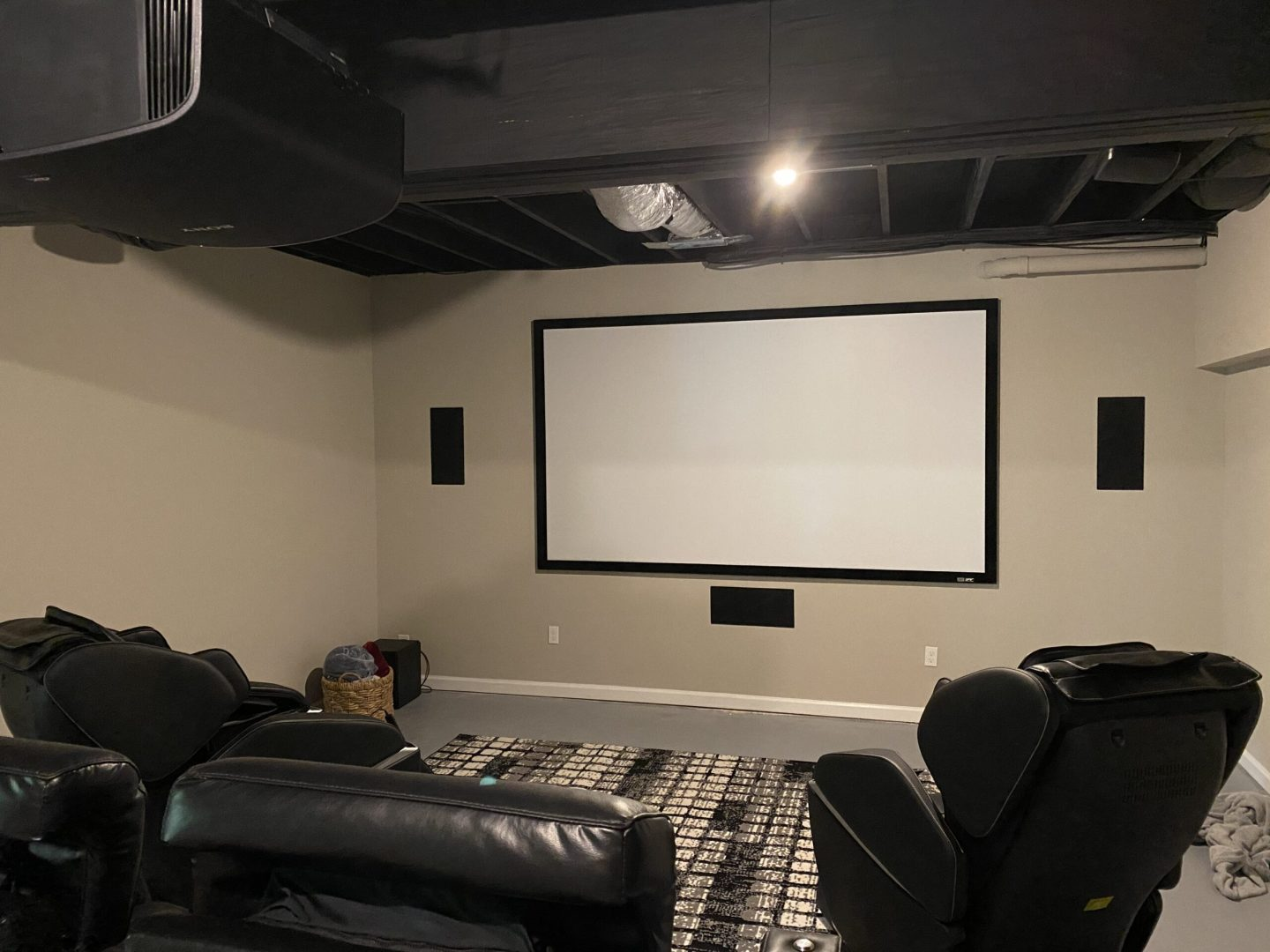 Extra large TV installation and wall mount with surround sound system