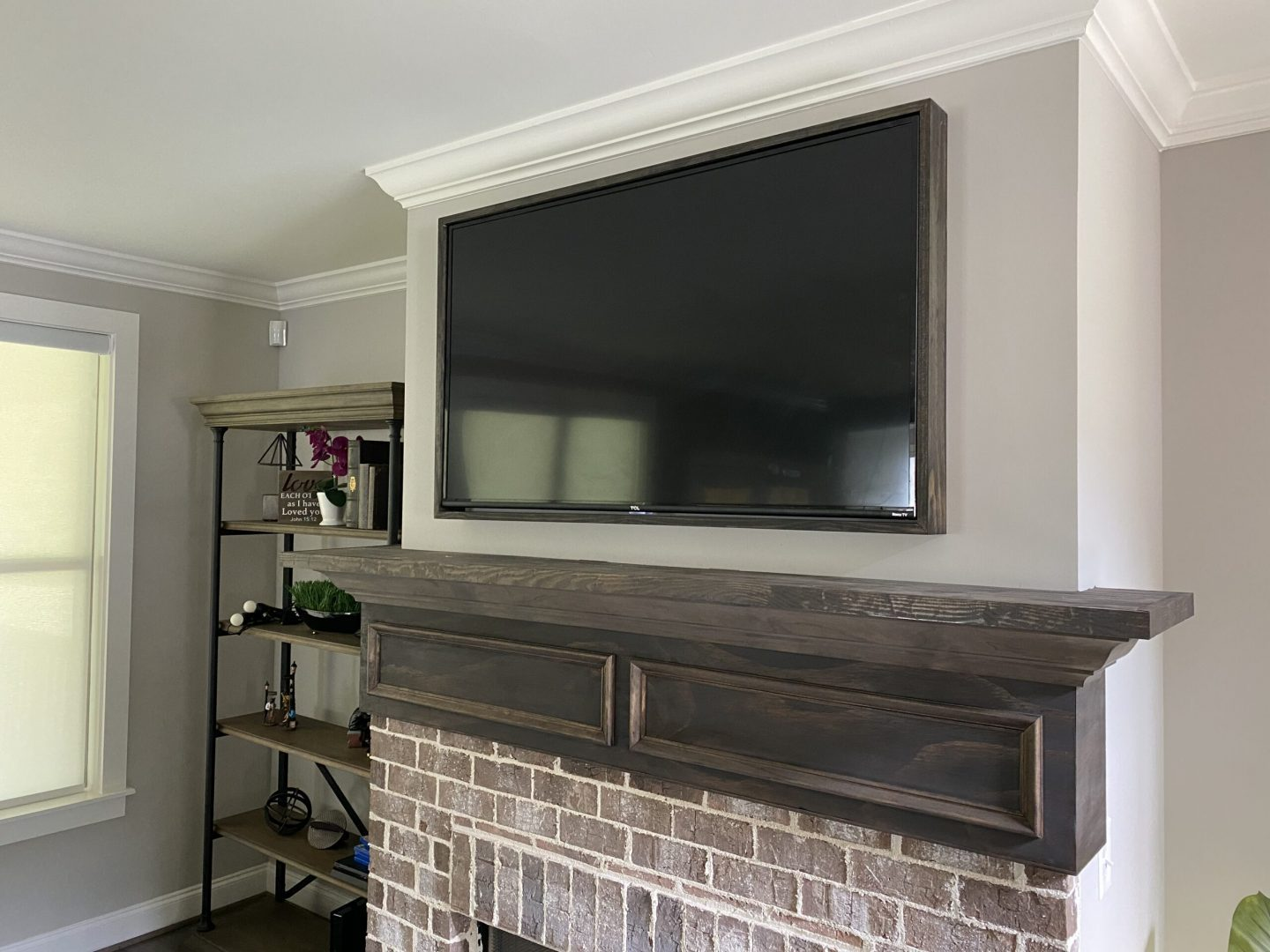 TV installation and mounted above fireplace