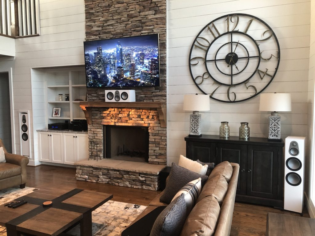 TV mounted over fireplace in luxury home